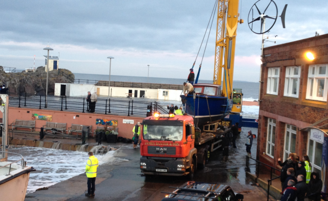 Girl Pat Is Strapped Down for Removal—Note Water from Afternoon Tide on Esplanade & Flowing into Harbour