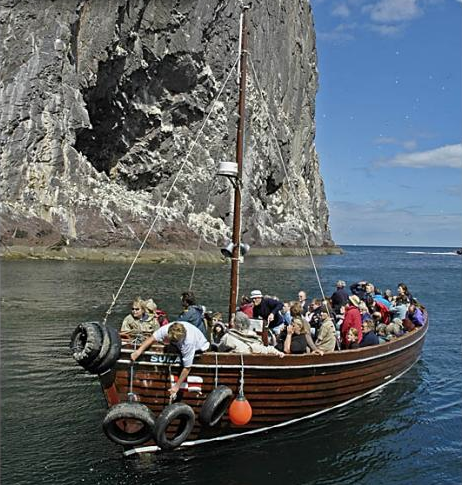 Sula II with Chris at the Wheel and Pat Preparing Fenders Approaches the East Landing of Bass Rock